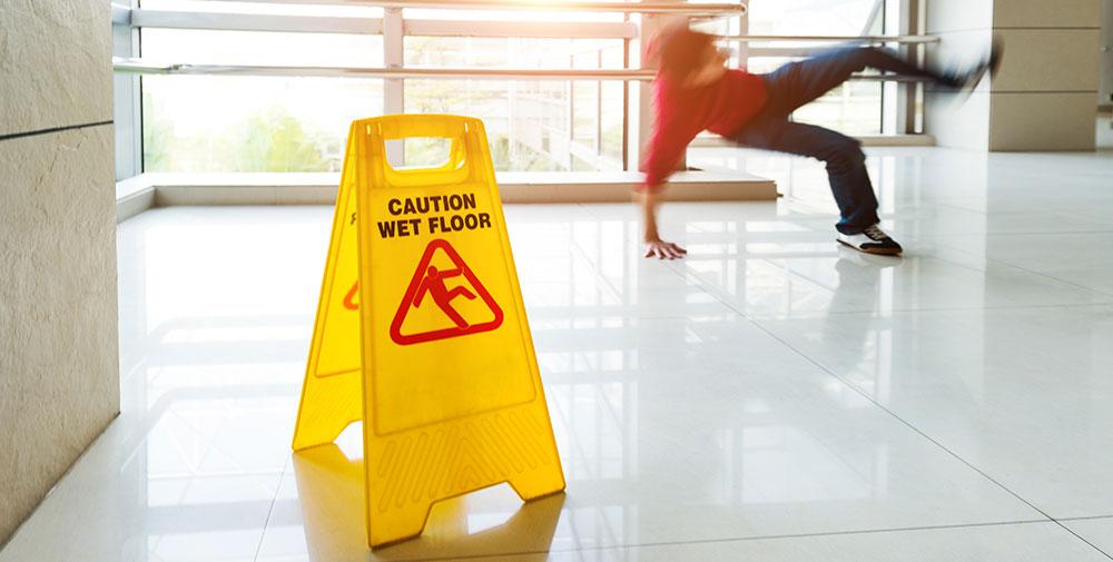 man falling on wet tile
